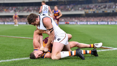 Wrestle-off: Heath Shaw grapples with Dayne Zorko in an incendiary semi-final.