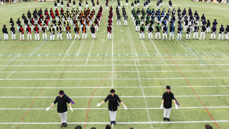 Colour-coded teams prepare for a botaoshi tournament at the Kaisei Gakuen school's annual festival in Tokyo.