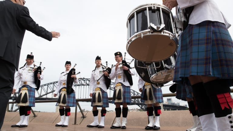Members of The Royal Edinburgh Military Tattoo assemble for the announcement that they will be coming to Sydney in 2019.