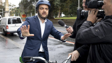 Sam Dastyari arrives on a lime bike to give evidence at the ICAC inquiry into alleged illegal donations to the Labor Party.