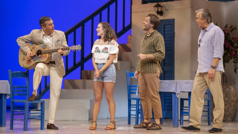 Sophie invites her three potential fathers to her island wedding. L-R:  Phillip Lowe as Harry, Sarah Morrison as Sophie, Josef Ber as Bill, Ian Stenlake as Sam.