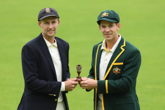 England captain Joe Root with the Ashes and Australian skipper Tim Paine.