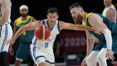 Australia's Aron Baynes (right) vies with Italy's Marco Spissu for the ball.
