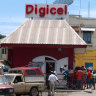 Telstra seals $US1.6b deal to buy Digicel with a helping hand from Canberra