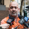 Father of accused cop bashers charged over Facebook threats to police