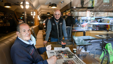 Lygon Street shops and restaurants prepare to open after lockdown. Cafe Notturno owner Salvatore Cultrera  (standing) with his uncle Bruno Cultrera are opening to dine-in customers from 6am on Wednesday.