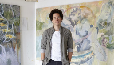 Michael Armitage in front of his painting Lacuna.