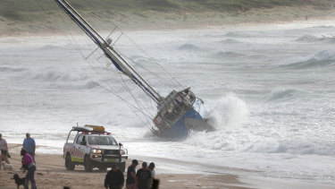 The boat 'Sailing Free' is now stranded on Wanda Beach.