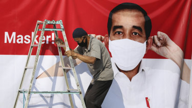 Virus awareness billboards in Jakarta feature President Joko Widodo. Although not the hardest hit, Indonesia is still struggling to contain the spread.