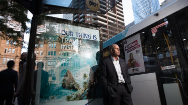 JCDecaux CEO Steve O'Connor next to a bus stop. The decision by the City of Sydney will see inventory like this disappear.