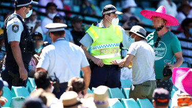 Prateik Kelkar (grey shirt) remonstrates with police after spectators were ejected from the SCG.