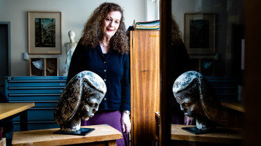 National Art School curator Deborah Beck with Anita Aarons' sculpture Portrait bust of a woman 1939, which was returned to the school in 2015 after it was removed sometime in the 1980s. It is now on display in the NAS Archive and Collection rooms.