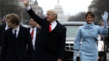 Donald Trump and Melania Trump wave during his inauguration parade on Pennsylvania Avenue, Washington, in 2016.