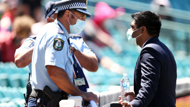 Police speak with a member of the Indian team staff at the SCG.