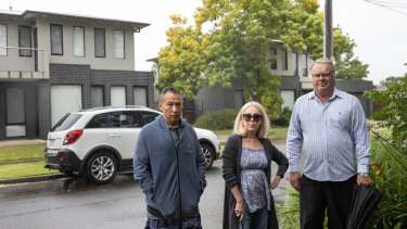 Michael Fong, Sandra MacFarlane and John Muelan, former clients of disgraced tax agent Richard Hogg outside his Cheltenham townhouse.
