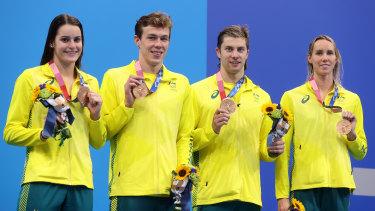 Kaylee McKeown, Zac Stubblety-Cook, Matthew Temple and Emma McKeon receive their bronze medals.