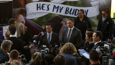 "Tone deaf: NSW Racing Minister Paul Toole and Greyhound Racing NSW CEO Tony Mestrov are backed by a ""He's My Buddy"" sign, with no sense of irony."