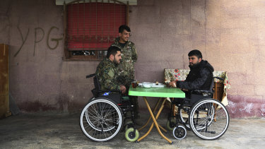 Injured Syrian Democratic Forces soldiers Ibrahim Bazem, 25, left, Sipan Ezzo, 20 (centre) and Swar Rojdam, 23, recuperating from their injuries sustained whilst fighting Islamic State.