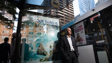 JCDecaux CEO, Steve O'Connor, next to a bus stop and buses displaying their advertising, in Sydney.