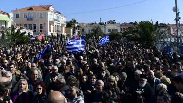 Protesters gather in Mytilene on Lesbos. Local authorities declared a 24-hour strike on two eastern Greek islands to protest against government plans to build new migrant detention camps there.