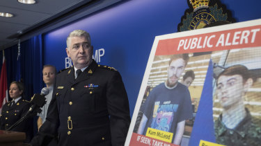 Security camera images recorded in Saskatchewan of Kam McLeod, 19, and Bryer Schmegelsky, 18, are displayed as RCMP Assistant Commissioner Kevin Hackett speaks at the beginning of the manhunt.