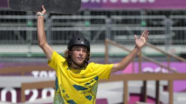 Keegan Palmer celebrates the inaugural men's park skateboarding gold medal.