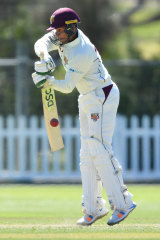 Caught on the hop: Usman Kjawaja on the defensive against the Tasmanian attack.
