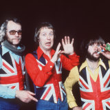 The Goodies wearing Brooke-Taylor's  trademark Union Jack waistcoat.
