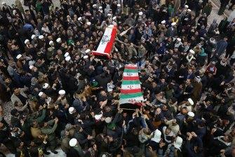 Mourners in Baghdad carry the coffins of Iran's General Qassem Soleimani and Mahdi al-Muhandis, the Iraqi deputy commander of Iran-backed militia.