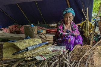 A woman in a makeshift tent in a displaced-person's camp in Kayah, eastern Myanmar. An estimated 108,800 people in the region have fled their homes following fighting between the military and the local militia.