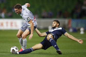Gianni Stensness of the Mariners is tackled by Victory's Rudy Gestede.