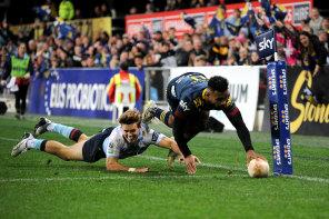 Jona Nareki dives over in the corner for the Highlanders on Saturday night.