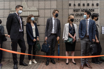 Consular representatives from Australia, from second right, Canada, Sweden, France and the Netherlands stand in line outside the West Kowloon Magistrates Courts ahead of Friday's hearing.