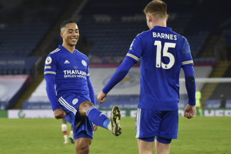 Harvey Barnes (right) celebrates with Youri Tielemans - from a distance - after scoring Leicester's second goal.