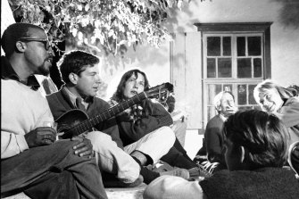 Canadian poet, author and musician Leonard Cohen (second left) plays guitar on Hydra with, among others,   Charmian Clift (third left), and Norwegian expatriate Marianne Jensen (also known as Ihlen) in October 1960.