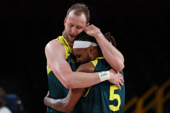 Joe Ingles and Patty Mills hug after winning the bronze medal game in Tokyo. Could they do it again in Paris?