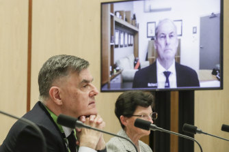 Department of Health Secretary Dr Brendan Murphy and Minister for Aged Care and Senior Australians Richard Colbeck appearing via videoconference, during a Senate select committee hearing on COVID-19, at Parliament House in Canberra.