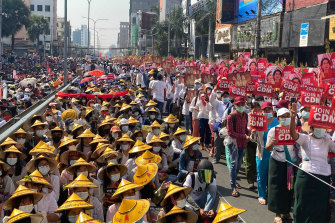 Anti-coup protesters fill the main road during a rally in Mandalay on Monday.