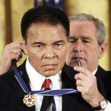 The US president George W Bush presents the Presidential Medal of Freedom to boxer Muhammad Ali in 2009.