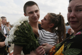Relatives greet freed Ukrainian prisoners freed as they step off a plane in Kiev.