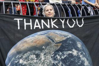 Jemila MacEwan, a supporter of Swedish environmental activist Greta Thunberg, awaits her arrival at a marina in New York.
