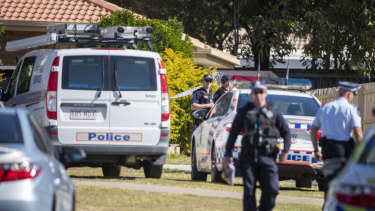 Police, forensic officers and Ethical Standards Command investigators swarmed the quiet cul-de-sac on Monday.