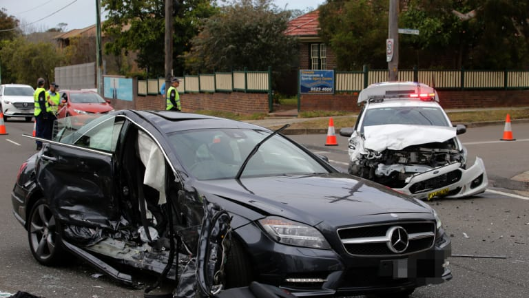 A police car and Gay Vieira's Mercedes-Benz after the serious collision in Cronulla.