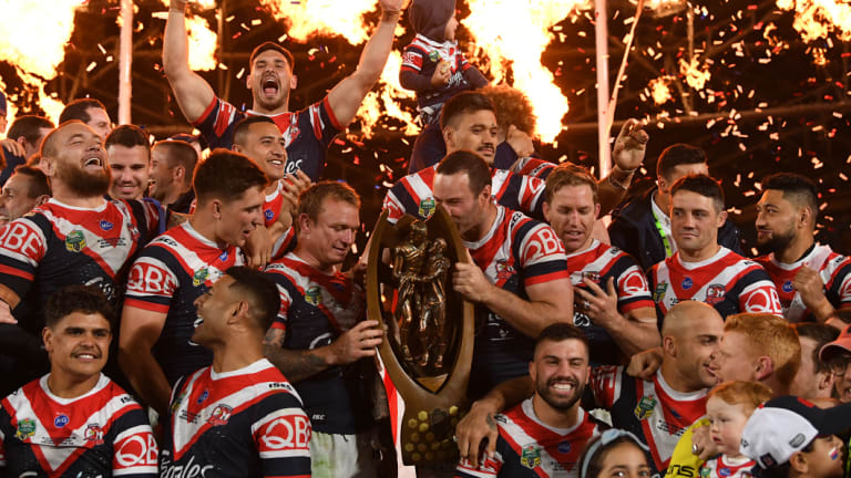 Grand moment: The Roosters set the stadium alight with a scintillating display to see off the Melbourne Storm.