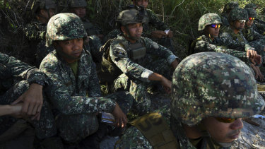 Marines sit on the beach at the Philippine Marine Corp Barracks Gregorio Lim in Ternate, Luzon.