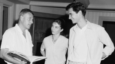 Young stars Anthony Perkins and Donna Anderson rehearse under the watchful eye of director Stanley Kramer.