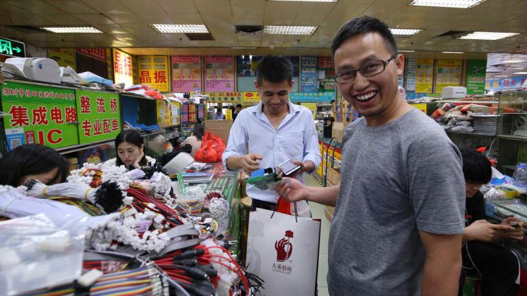 Li Feng buying electronic parts  in Shenzhen's Huaqiangbei Commercial Street.