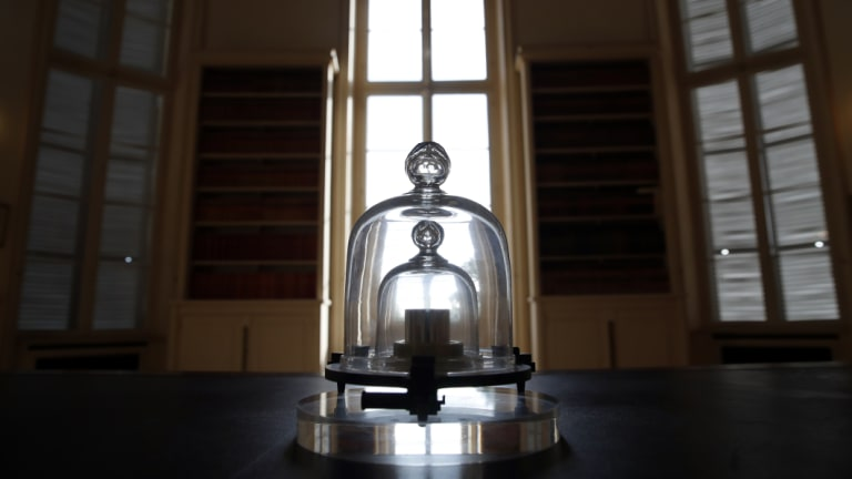 A replica of the International Prototype Kilogram   at the International Bureau of Weights and Measures, in Sevres, near Paris.