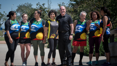 ActewAGL general manager retail Ayesha Razzaq with Indigenous Marathon Foundation directo Robert de Castella and local Deadly Runners Cara Smith, Jess Martin, Jess Skipper, Denis Reid, Tamsin Porter and Louise Lippitt. Photo Elesa Kurtz