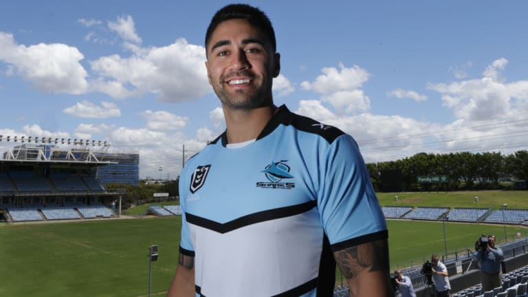 Shark sighting: Shaun Johnson tries on his new colours at Southern Cross Group Stadium on Thursday.